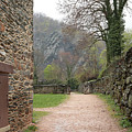 Stone Building Wall And Fence by Carol Groenen