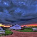 Storm At Sunset by Dale Kauzlaric
