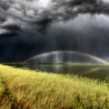 Storm Clouds And Rainbow Over Chaplin Lake Marshes by Mark Duffy