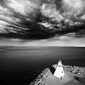 Storm Clouds Over A Lighthouse  by Julius Reque