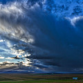 Storm Clouds Over Farmland #2 - Iceland by Stuart Litoff
