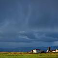 Storm Clouds Over Farmland - Iceland by Stuart Litoff