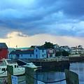 Storm Clouds Over Rockport Harbor by Harriet Harding