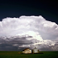 Storm Clouds Over Saskatchewan Granaries by Mark Duffy