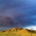 Storm Rolling Across Sun Dappled Mountains by David Stevens