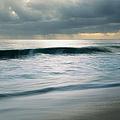 Stormcloud Over Keawaula Beach by Charmian Vistaunet