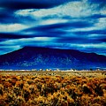Stormy Day In Taos by Charles Muhle