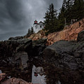 Stormy Reflections At Bass Harbor Head Light by Jesse MacDonald