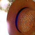 Straw Hat Hanging In Sunny Cottage by David Prahl