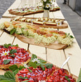Strawberry Cake And Other Snacks On A Wood Table Outdoors On Sta by Reimar Gaertner