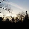 Streaks Of Clouds In The Dawn Sky by Kent Lorentzen
