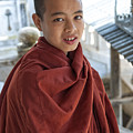 Street Portrait Of A Young Monk by Artur Pirant
