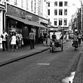 Street Riding In Amsterdam Mono by John Rizzuto