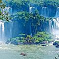 Subtropical Vegetation Surrounds Waterfalls In Iguazu Falls National Park-brazil by Ruth Hager