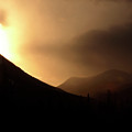 Sun Behind Clouds In Rocky Mountains Of Alberta Canada by Mark Duffy
