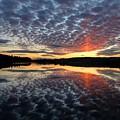 Sun Pillar At Sunset by John Meader
