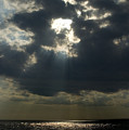 Sun Rays Pierce Through Clouds And Rest by Todd Gipstein