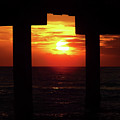 Sun Setting At The Pier by D Hackett