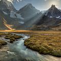 Sun Setting  Behind Jirishanca Peak by Colin Monteath