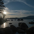 sun setting over the mountains at Lake Tahoe by Dan Friend