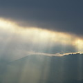 Sunbeams Through Clouds On Mountain Range By Stormy Day by Sami Sarkis