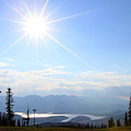 Sunburst Over Lake Dillon by Paula Guttilla