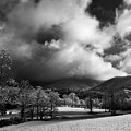 Sunlight Clouds And Snow In Black And White by Greg Mimbs