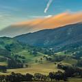 Sunlit Clouds On A Ridge by Marc Crumpler