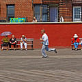 Sunny Morning On A Boardwalk In Brighton Beach  by Zalman Latzkovich