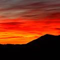 Sunrise Against Mountain Skyline by Max Allen
