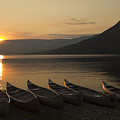 Sunrise And Canoes On Adams Lake by Richard Reinders