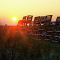 Sunrise And The Lifeguard Chairs  by Bill Cannon