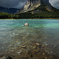 Sunrise At Swiftcurrent Lake by Rick Strobaugh