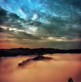 Sunrise Moonset Over The Breaks by Thomas R Fletcher