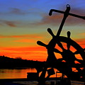 Sunrise Over The Captain's Wheel by Suzanne DeGeorge