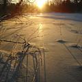 Sunrise Reflecting Off Mississippi River Ice by Kent Lorentzen