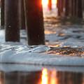 Sunrise Thru The Pier by Robert Banach