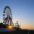 Sunrise Under The Ferris Wheel by Robert Banach