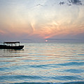 Sunrise With Boat, Zanzibar by Aivar Mikko