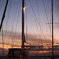 Sunset And Sailboat by Nadine Rippelmeyer