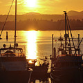 Sunset And The Boats by Kirt Tisdale