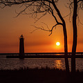 Sunset At The Lighthouse In Muskegon Michigan by Randall Nyhof