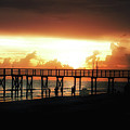 Sunset At The Pier by Bill Cannon