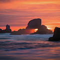 Sunset Behind Arch At Oregon Coast Usa by William Freebilly photography