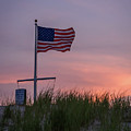 Sunset Flag Beach Dune Lavallette Nj  by Terry DeLuco