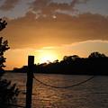 Sunset On The Dock by April Camenisch