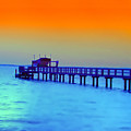 Sunset On The Pier by Bill Cannon