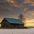 Sunset On The Snowy Fields by Jukka Heinovirta