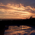 Sunset Over A Pool by Edan Chapman