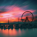 Sunset Over National Harbor Ferris Wheel by Dominic Morrocco